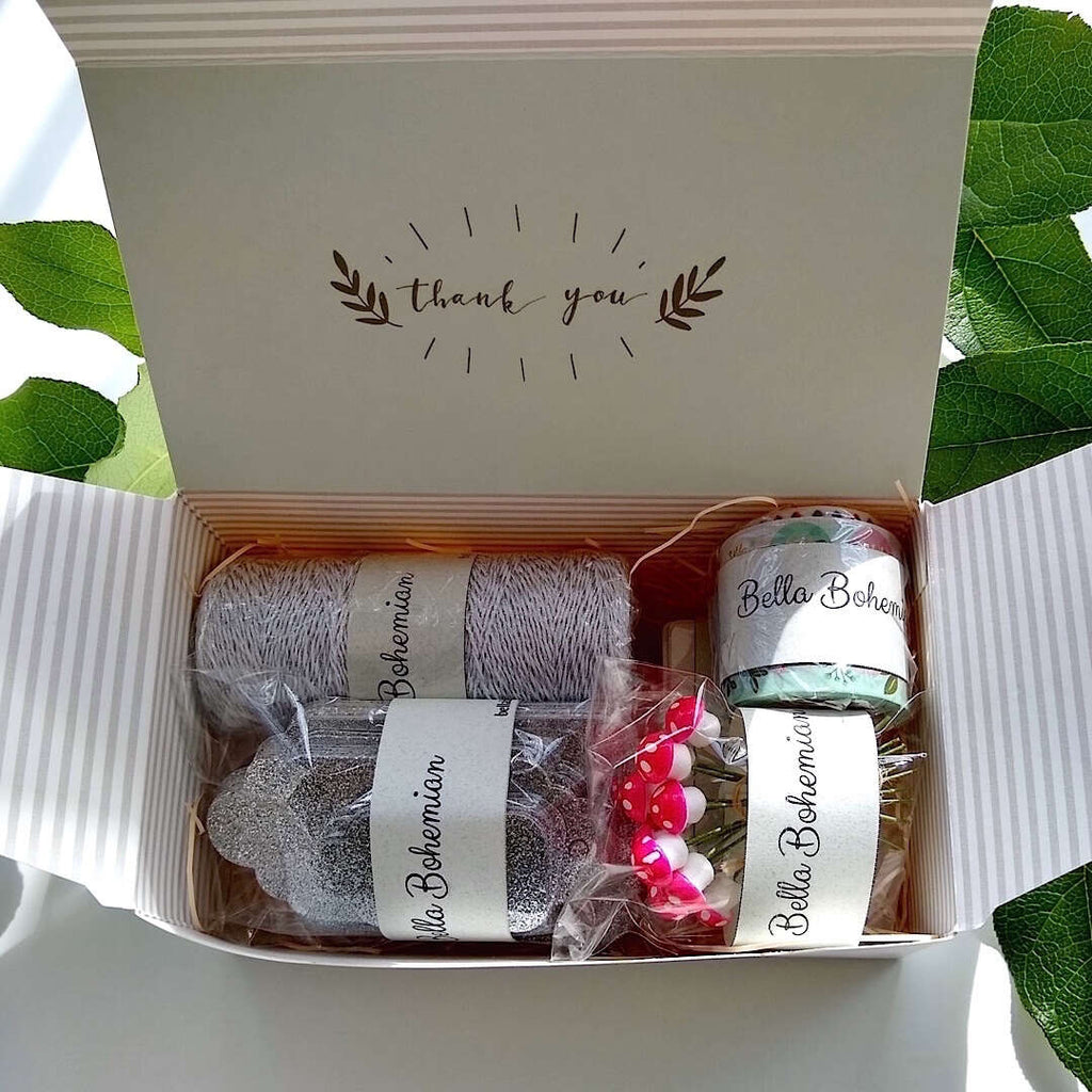 silver luxe glitter gift cards, white hang tags, German cotton spun mushrooms, metallic glitter bakers twine, plastic wrapped in gift box