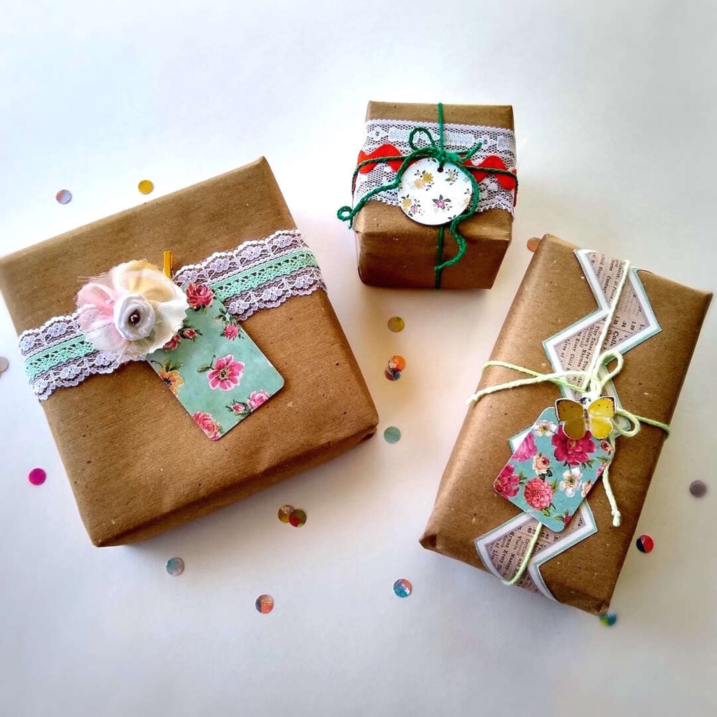 3 example wrapped gift boxes with gift tags by Bella Bohemian Papeterie