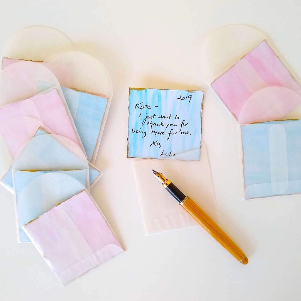pink and blue watercolor hand painted gift cards with glassine envelopes