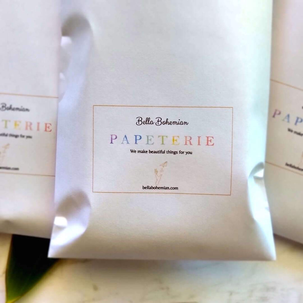 multiple papeterie packs packaged in Bella Bohemian branded envelope