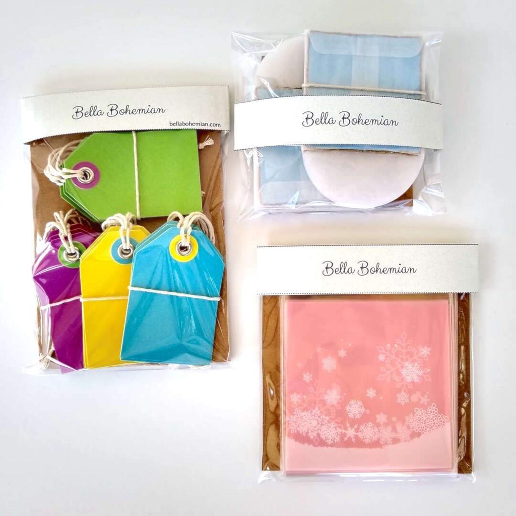 3 wrapped papeterie packs including gift tags, snowflakes favor bags, watercolor cards and glassine envelopes