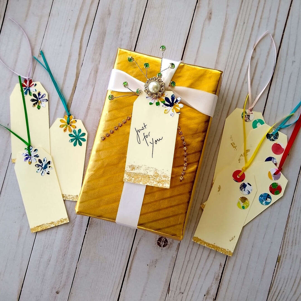 sample wrapped gift box with festive gift tags