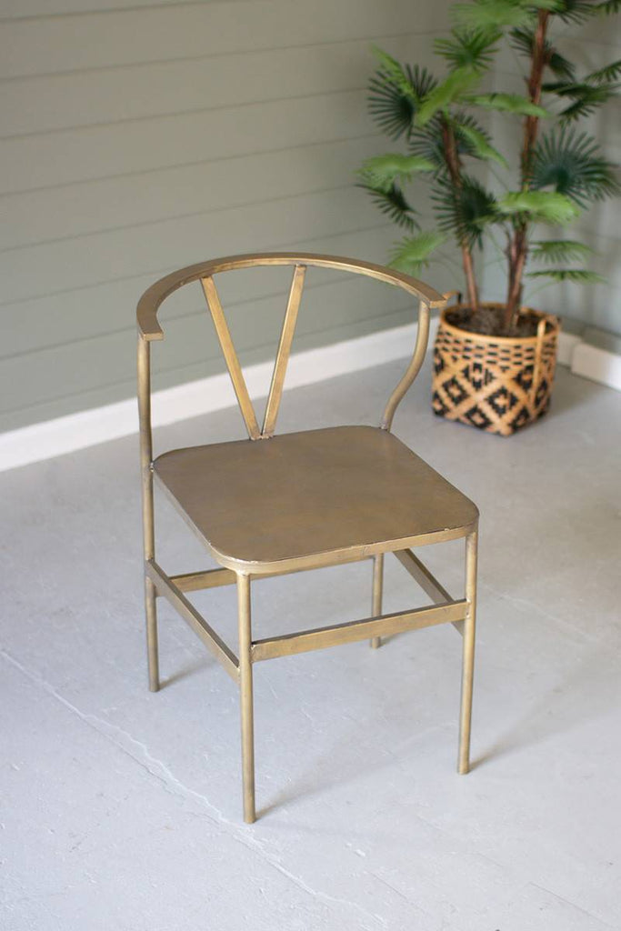 metal wishbone chair with brass finish