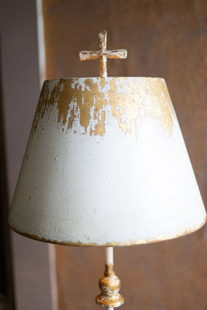 zoomed in on lamp shade and cross