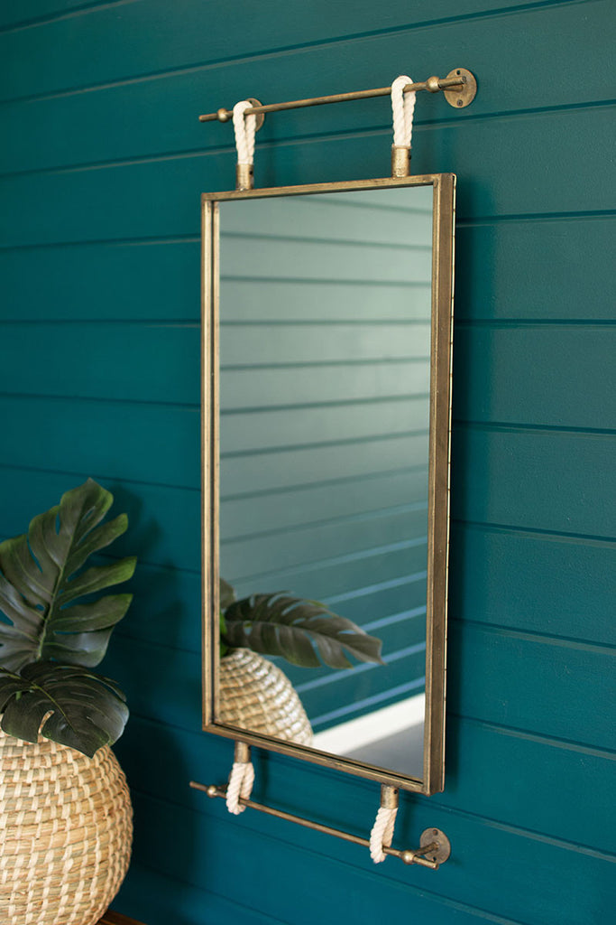 hanging wall mirror with brass frame and rope detail