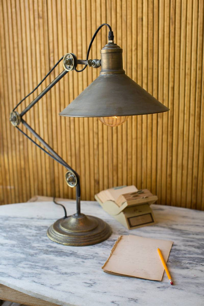 metal table lamp with pulleys as cable guides