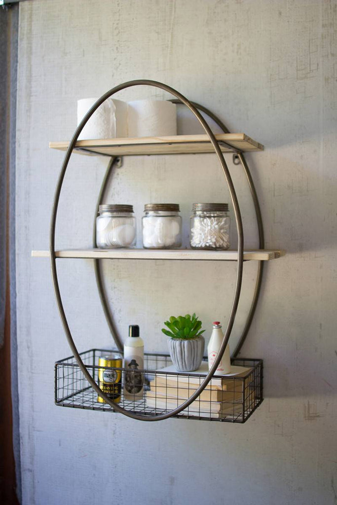 oval metal framed shelving unit with 2 wood shelves and one metal mesh basket