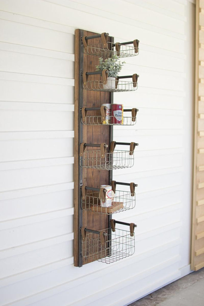 tall rustic dark wood and metal shelf rack with wire baskets