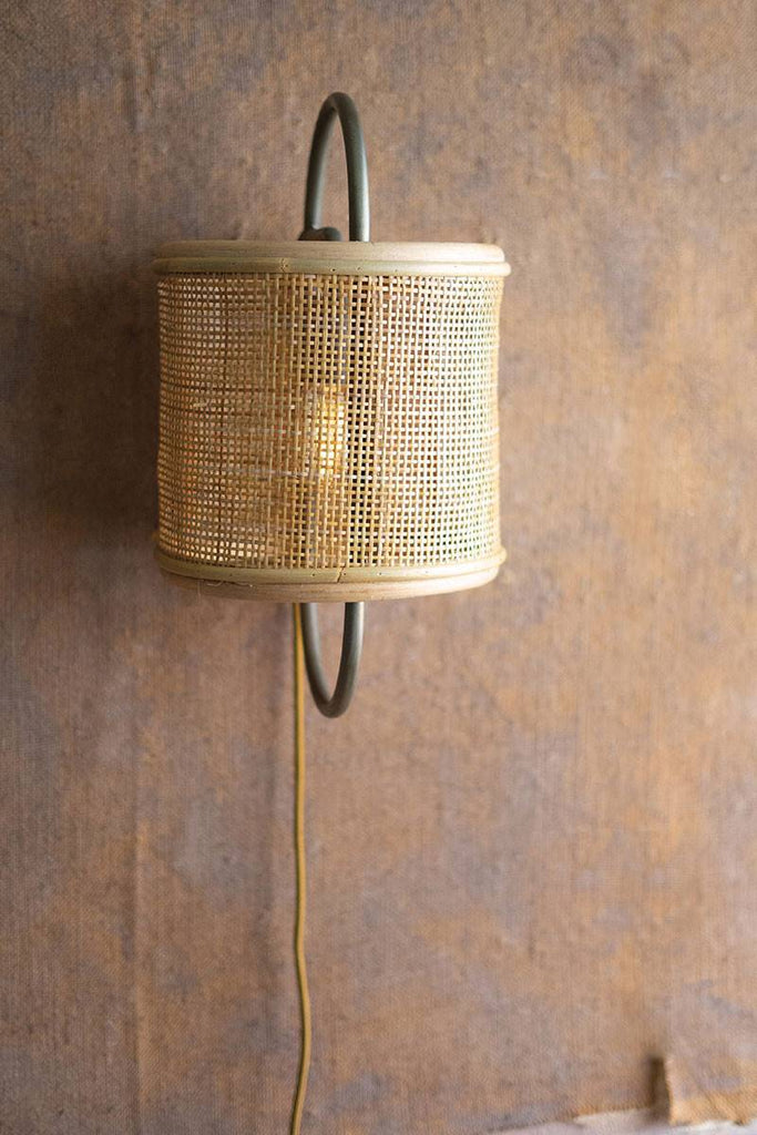 metal wall light with round rattan shade