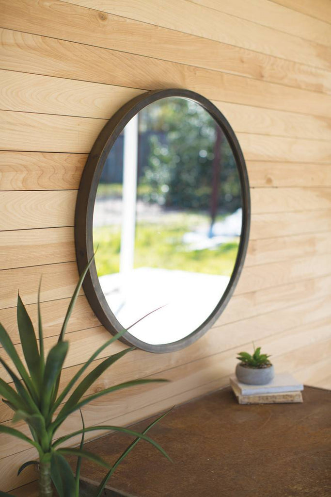 round wall mirror with natural metal frame