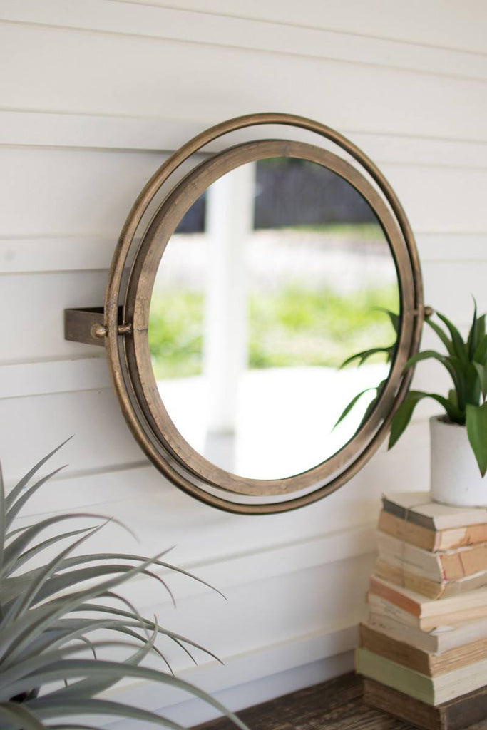 round and rotating wall mirror