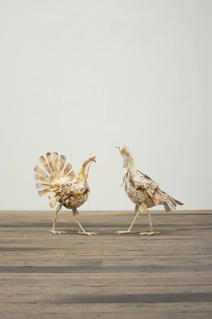 white metal turkeys seen from another vantage point