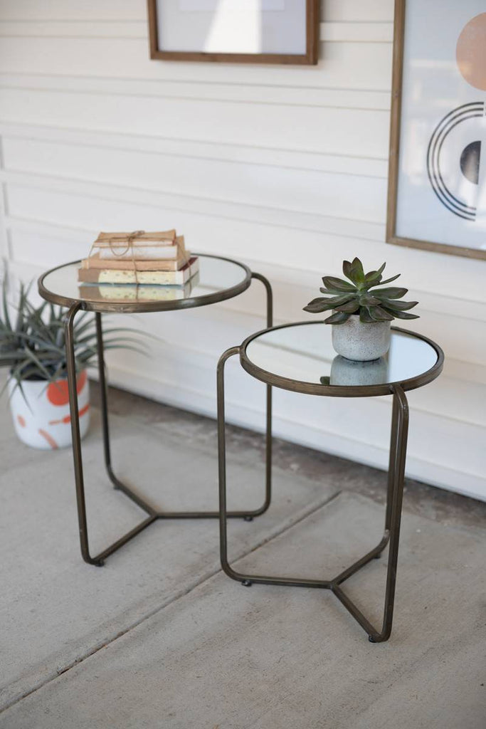 two metal side tables with glass mirror tops