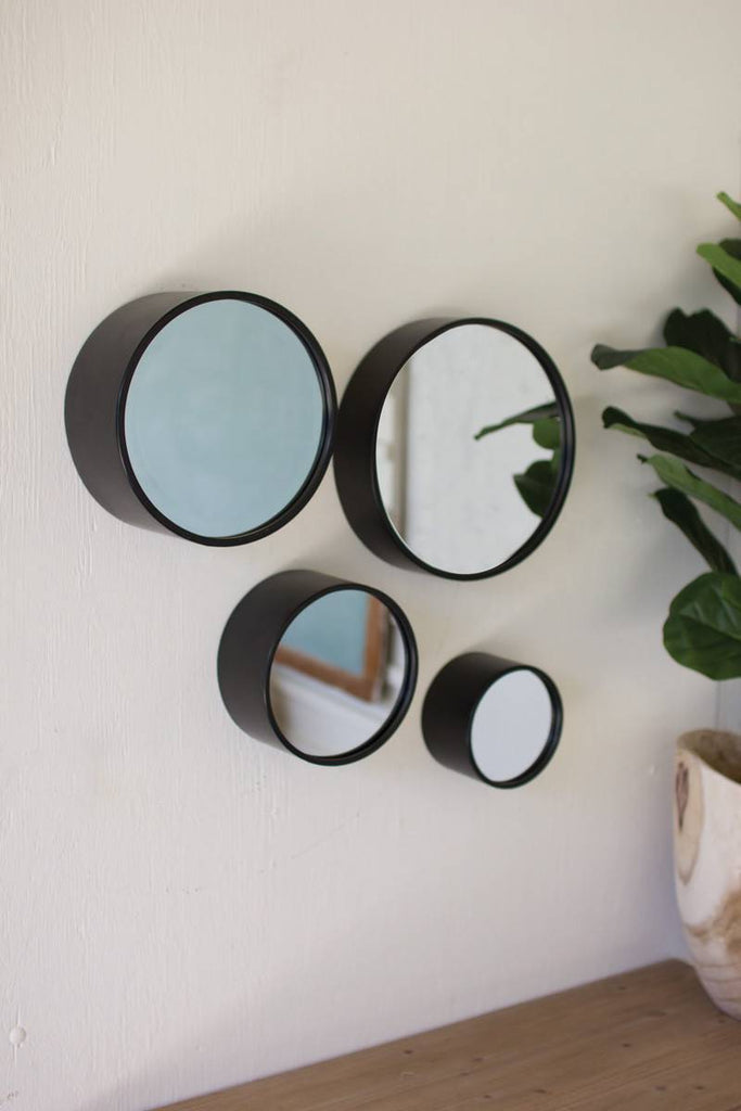 four round mirrors with black frame