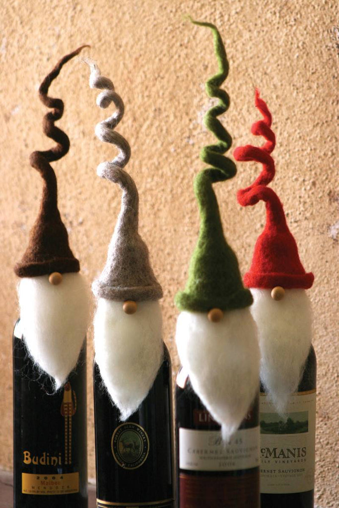 4 felt santa wine toppers with curly hats