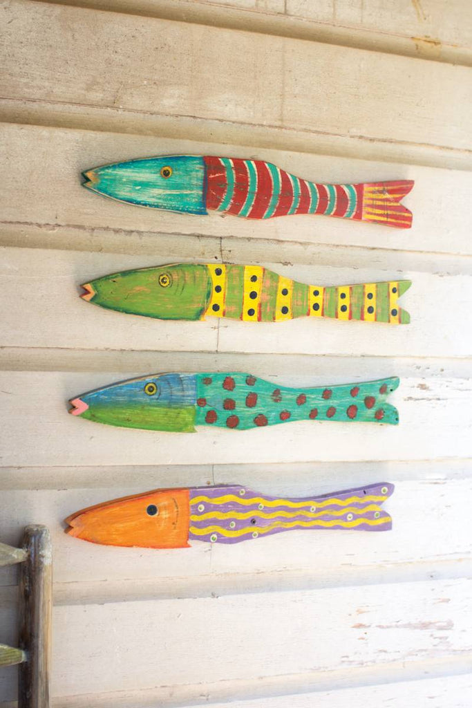 three painted wood fish wall art