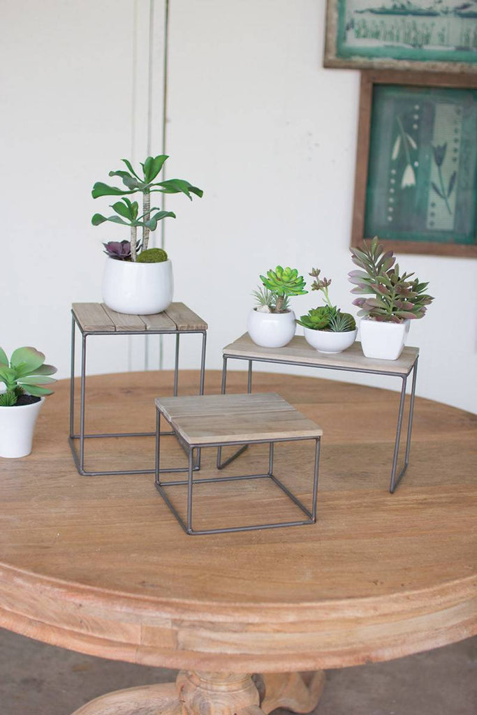 three square wood and metal table top risers