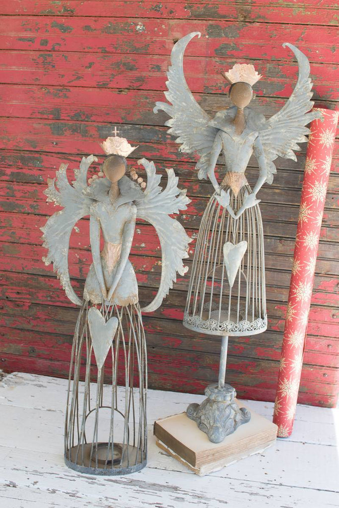 2 metal christmas angels with tea light holder at bottom