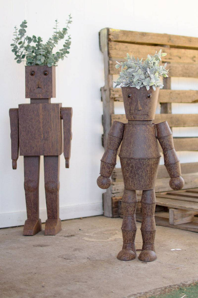 pair of robot shaped metal planters