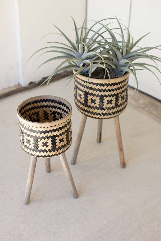 two woven bamboo plant stands with natural and black design
