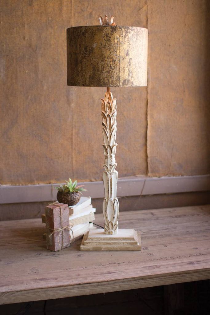 carved wooden base lamp with antique metal shade