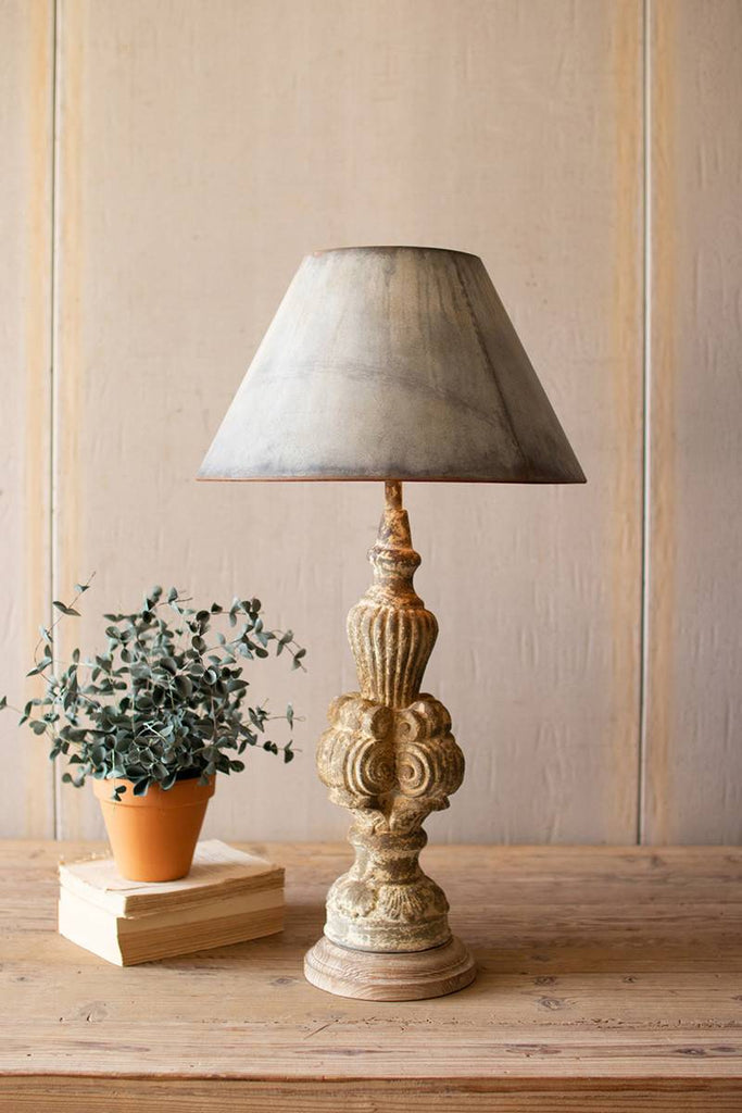 table lamp with sculpted base and galvanized lamp shade