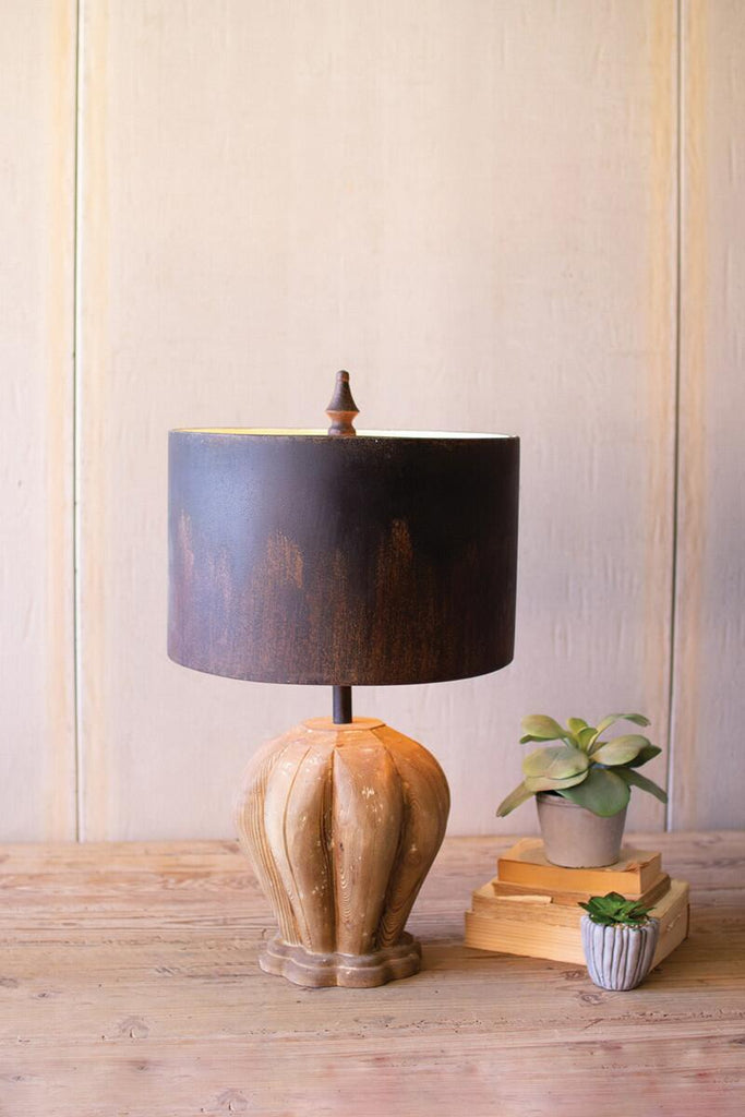 lamp with dark metal barrel shade and wooden base