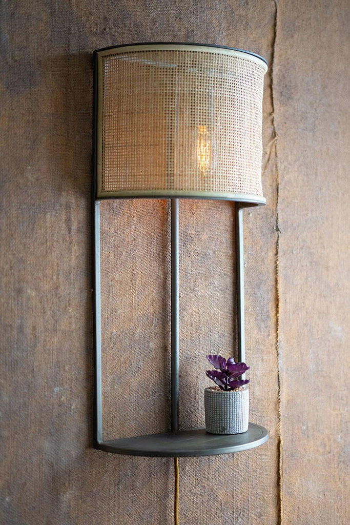 wall sconce with rattan shade and shelf