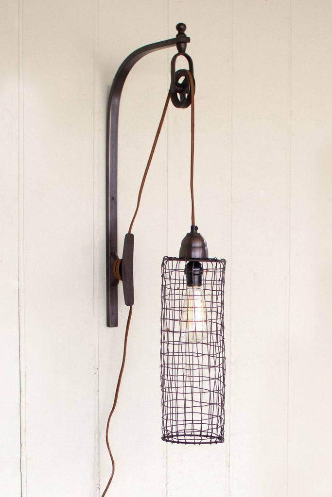 wire cylinder sconce suspended by pulley