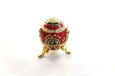 Faberge type Egg enamelled and Diamante encrusted hinged trinket box with Pearl
