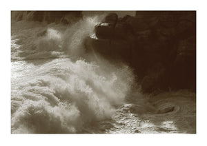 A Huge Wave Crashes Against the Rocks in Cornwall