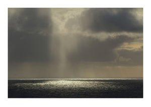 Dripping Light Through Clouds Over Sea
