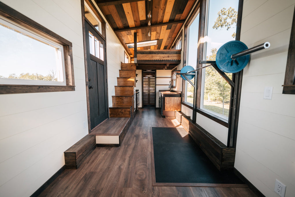 the silhouette by wind river tiny homes a crossfit gym in your tiny rh dreambiglivetinyco com Tiny High School Gym tiny house home gym