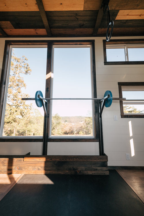 Silhouette Tiny House on Wheels with a Crossfit Gym by Wind River Tiny Homes