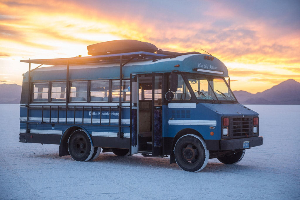 Blue Bus Adventure - Exterior with Sunset