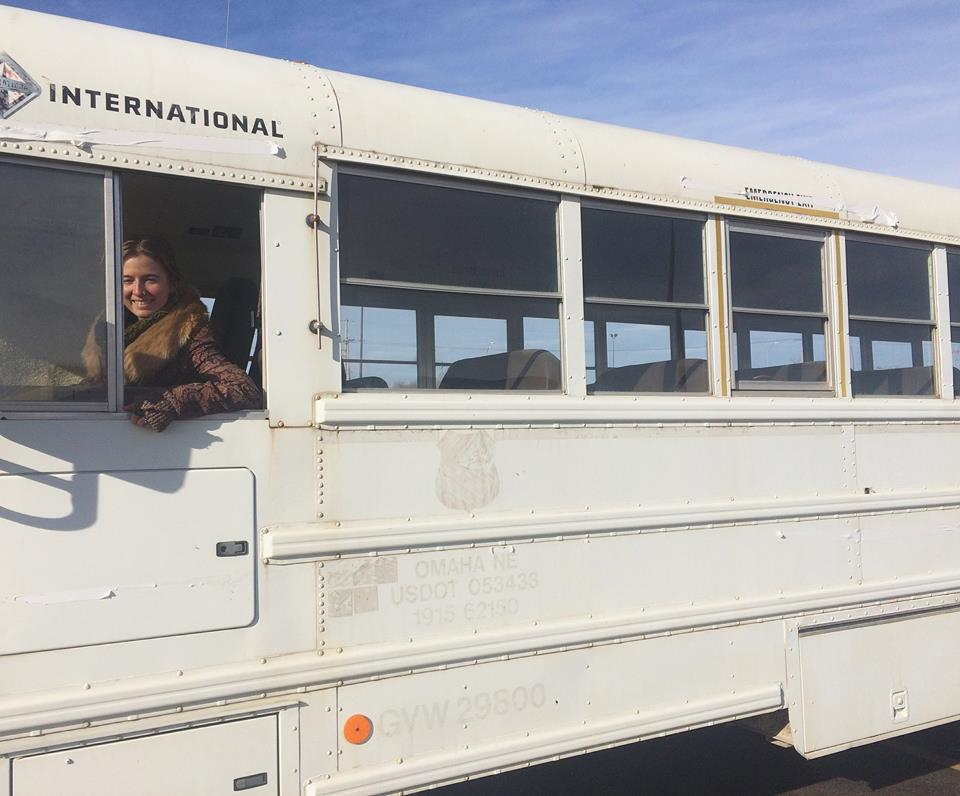 Dani Gallagher and her restored school bus, the Roaming Soul Apothecary