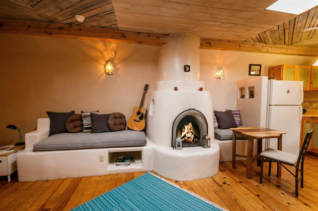 Santa Fe Pueblo Style Tiny Home Interior - Kiva Fireplace