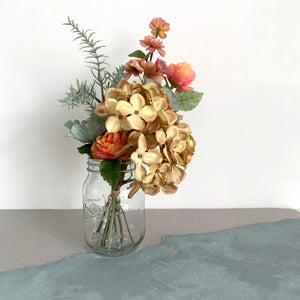 Artificial flower bouquet in vase autumn fall