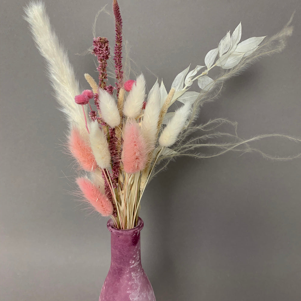 pink and white dried flower bouquet with bunny tails