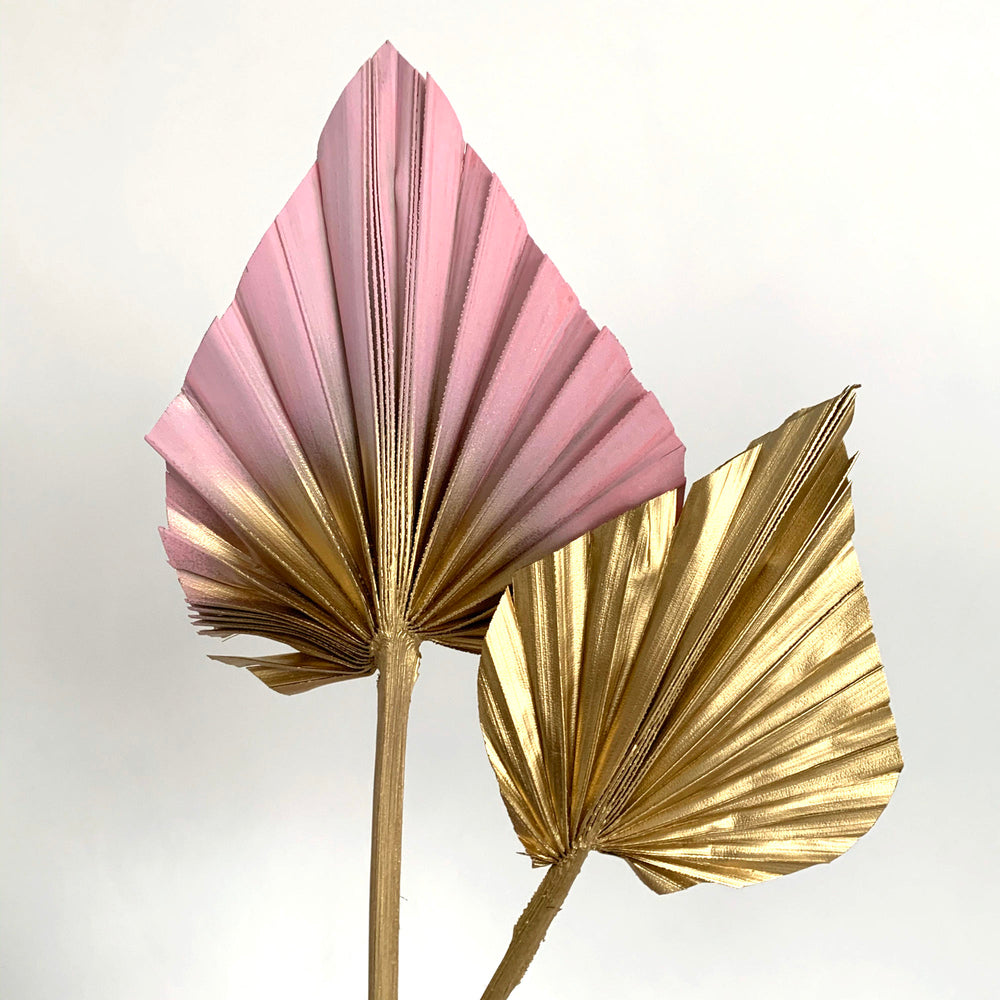 pink and gold palm spears cake topper