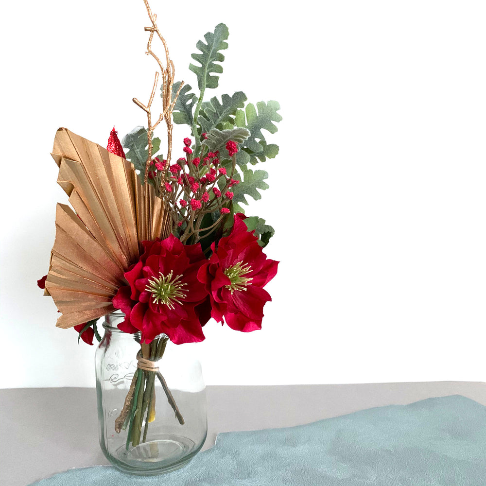 Christmas flower arrangement red and gold