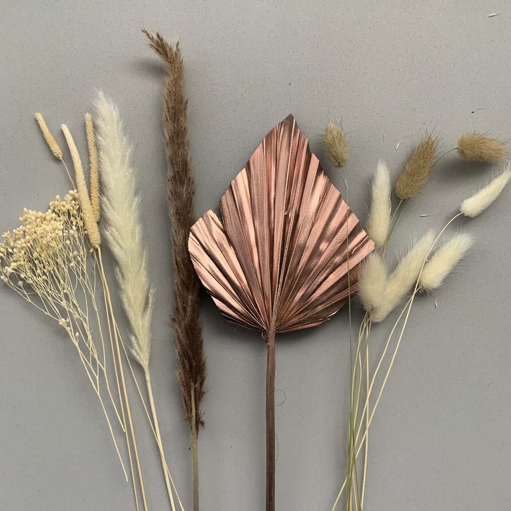 rose gold palm spear and white dried flowers for cake decoration