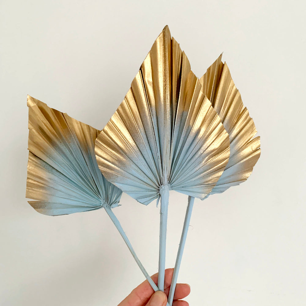 pastel blue and gold palm spears