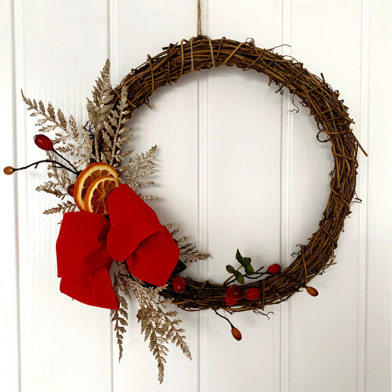 christmas wreath dried fruit red bow