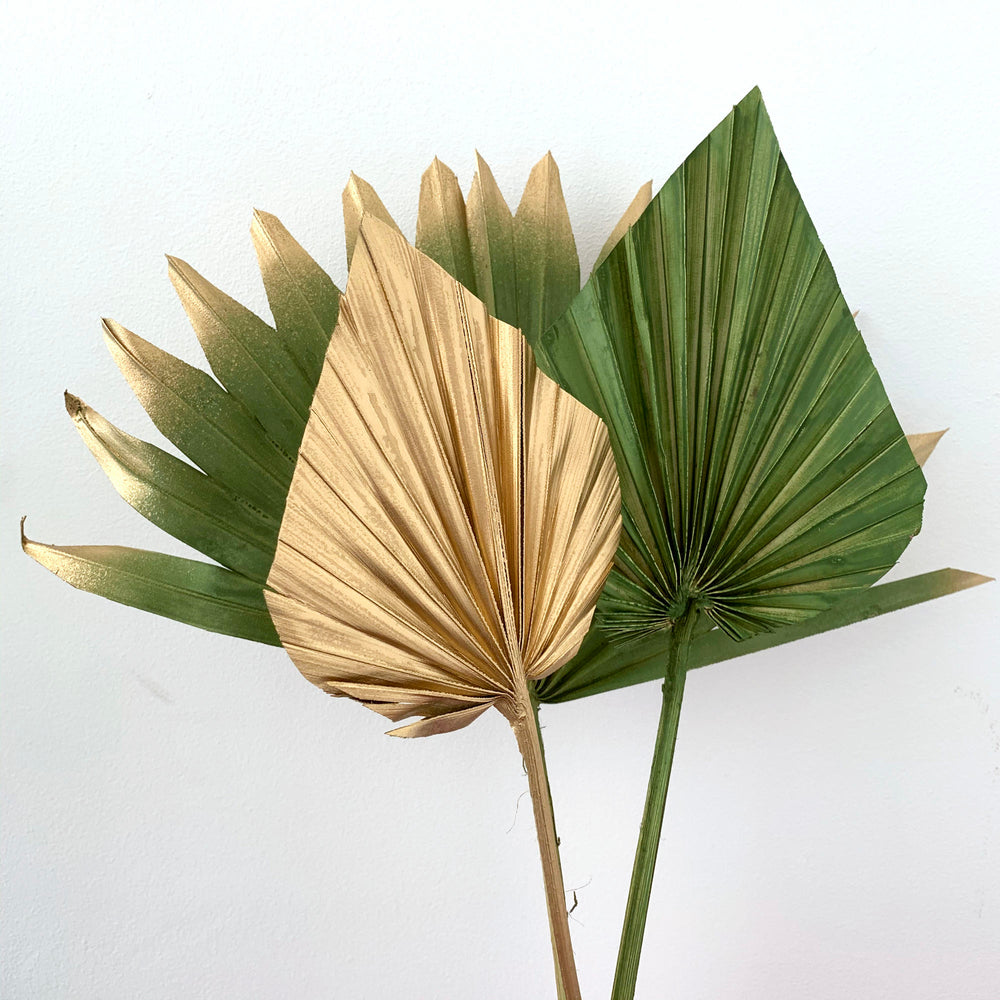 gold sun palm and palm spear cake topper