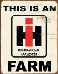 International Harvester Farm Logo Tin Wall Sign-Rainbow-Sleeping Giant