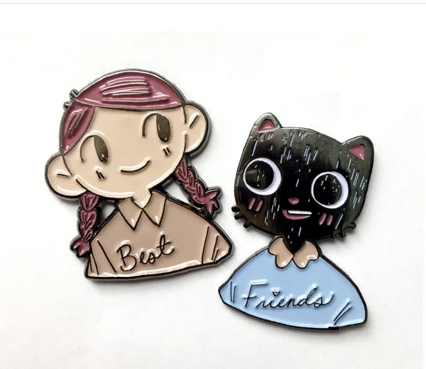 "Olive and Henry from Catboy enamel pins with ""Best"" and ""Friends"" on their shirts. 2 metal posts per pin."