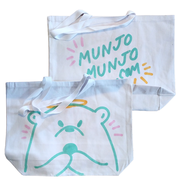 "hand-drawn one of a kind white tote bag with teal bear with a halo and pink action marks plus ""Munjo Munjo"" on the back"