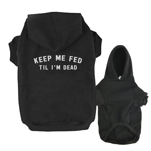 small dog hoodie with 'keep me fed til i'm dead' printed on the back plus features a slit for harness/leash connection