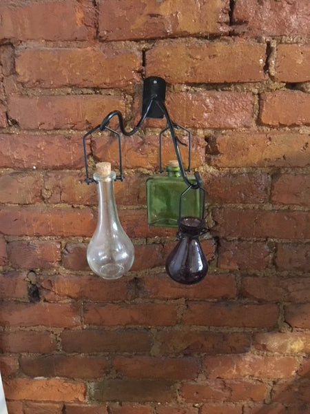 Three glass bottles on a hook